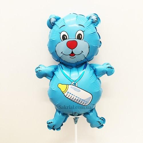 Красивый голубой мишка на палочке