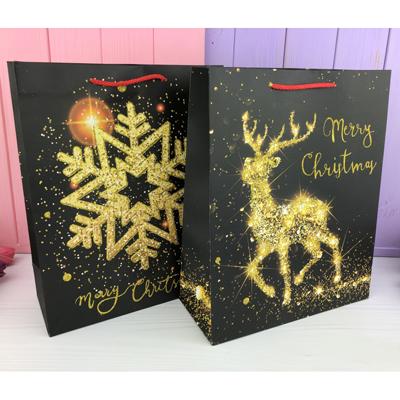 Подарочный пакет черный с золотом на Новый Год